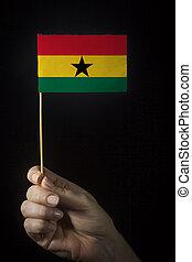 Hand with flag of Ghana