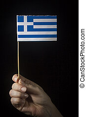 Hand with flag of Greece