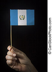 Hand with flag of Guatemala