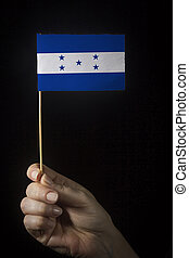 Hand with flag of Honduras