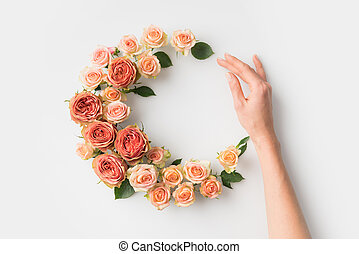 hand with flower wreath