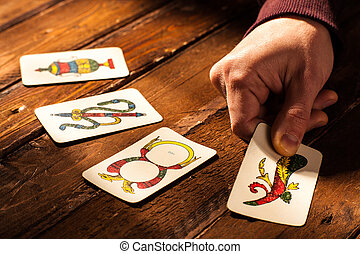 Neapolitan Cards - Hand with Four Aces of Neapolitan Cards