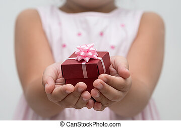Hand with gift box - Hand holding gift box with ribbons and...