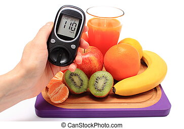 Hand with glucose meter, fresh natural fruits, glass of juice