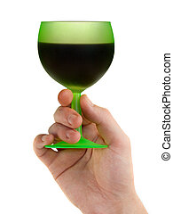 Hand with green glass of red wine