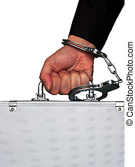 hand with handcuff and a suitcase