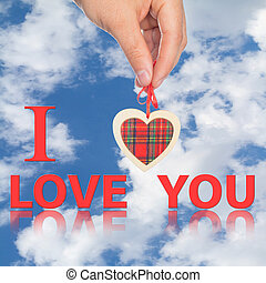 hand with heart and word I love you