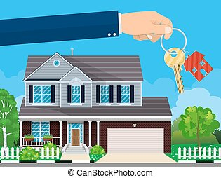 hand with house key and cottage