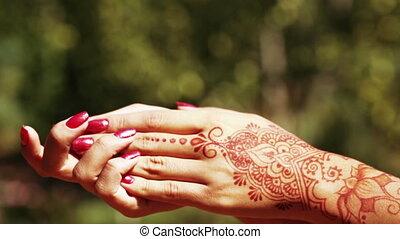 Hand with Mechendi - Girl with hands painted Mehandi....
