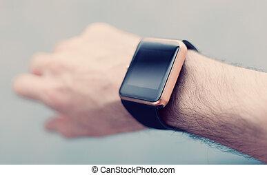 Hand with modern smart watch