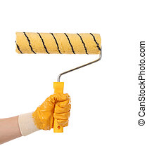 Hand with paintbrush roller.