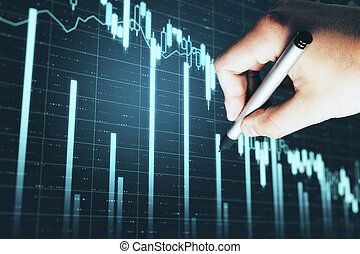 Hand with pen drawing stock crash chart