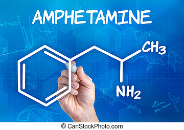 hand with pen drawing the chemical formula of amphetamine