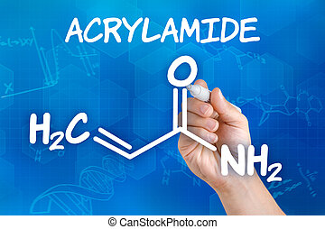 Hand with pen drawing the chemical formula of acrylamide