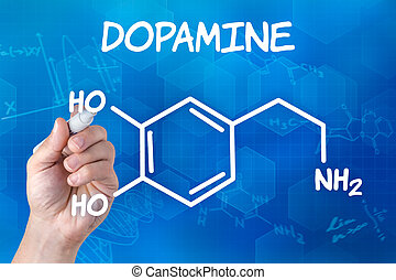 hand with pen drawing the chemical formula of Dopamine