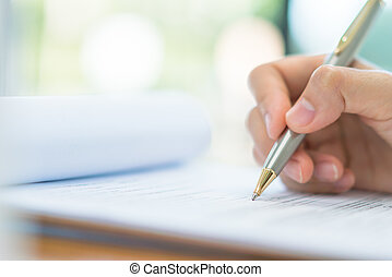 Hand with pen over application form . - Hand with pen over...