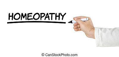 Hand with pen writing Homeopathy