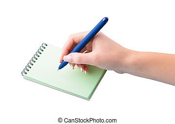 hand with pen writing on notebook