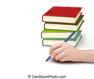 Hand with pen writing on paper and stack of books