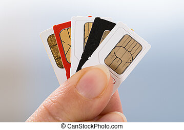 Hand With Phone Sim Cards - Close-up Of Person Hand Holding...