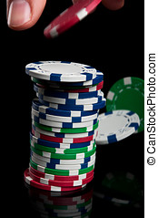 hand with poker chips