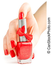 Hand with red manicure and nail polish. isolated