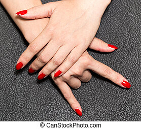 hand with red nail polish. rock