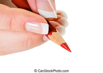 hand with red pencil - a hand holding a red pen. symbolic...