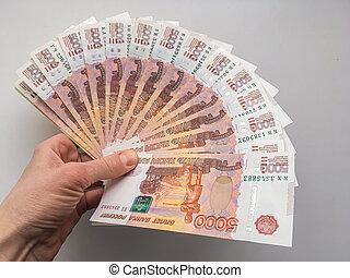 Hand with Russian rubles on a white background, bills five thousand rubles, money fan in hand