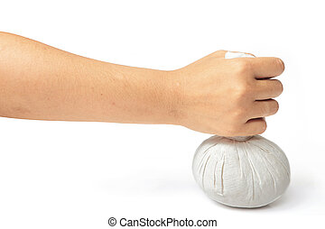 Hand with spa herbal balls on white backgroung.