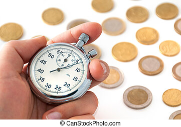 Hand with stopwatch and coins.