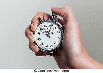 hand with stopwatch - a hand holding a stopwatch.