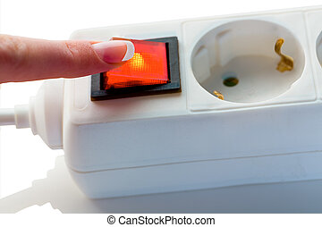 hand with switch for power - a hand shuts off the electric...