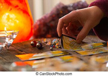 Hand with tarot card