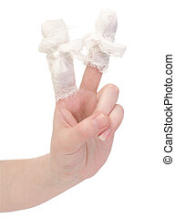 Hand with the bandaged, wounded fingers