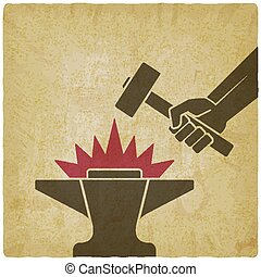 Hand with the hammer above anvil vintage background. vector...