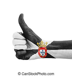 Hand with thumb up, Ceuta flag painted as symbol of excellence