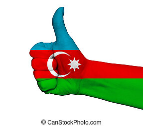 Hand with thumb up painted in colors of Azerbaijan flag isolated