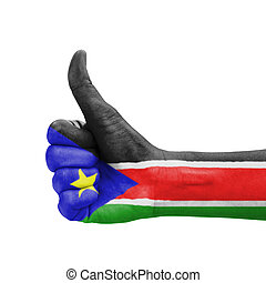 Hand with thumb up, South Sudan flag painted as symbol of...