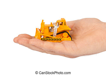 Hand with toy bulldozer
