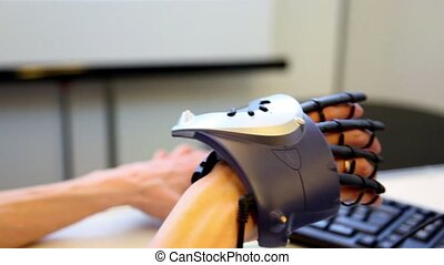 Hand with virtual manipulator moves at background of keyboard, closeup view