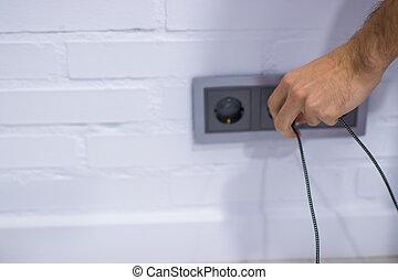 hand with wall plug
