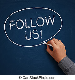 Follow Us! - Hand with white chalk writing 'Follow Us!' on ...