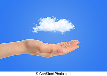 Hand with white cloud on blue background