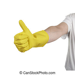 hand with yellow cleaning product glove showing thumb up....