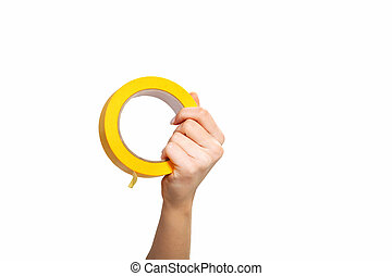 hand with yellow tape