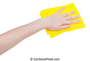 hand with yellow wiping rag isolated on white