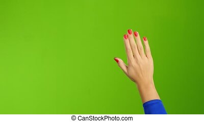 Hand woman waving hello or goodbye on green screen...