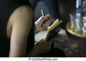 Hand (woman) writing pen notebook