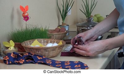 hand wrap egg into material scrap. Prepare egg Easter fest....